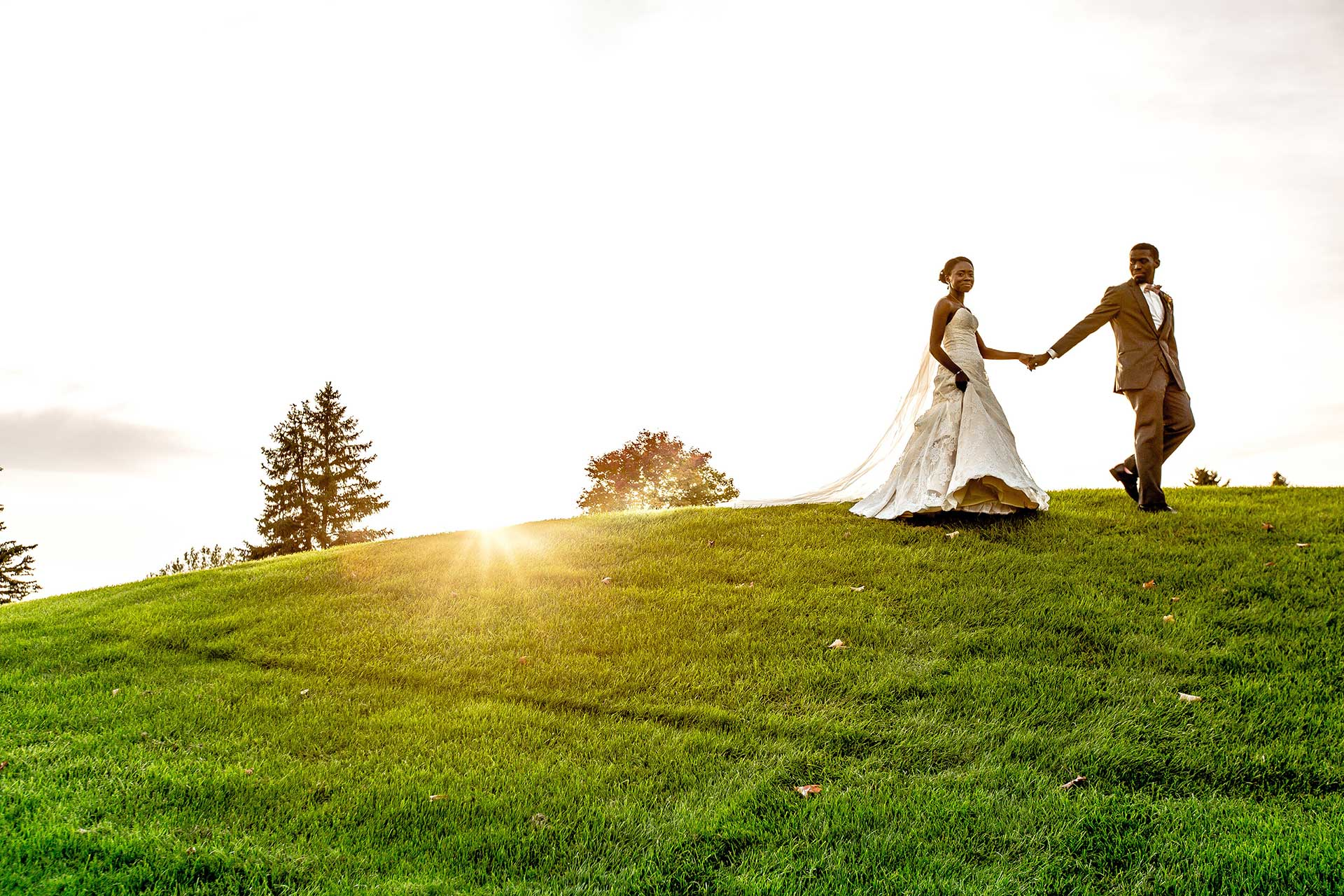 Groom and Bride holding hands on Braemar Golf Course